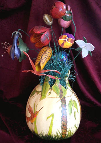 painted birds on gourd vase with artificial flowers for table decoration
