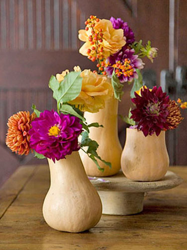 fall flowers in white gourd vases