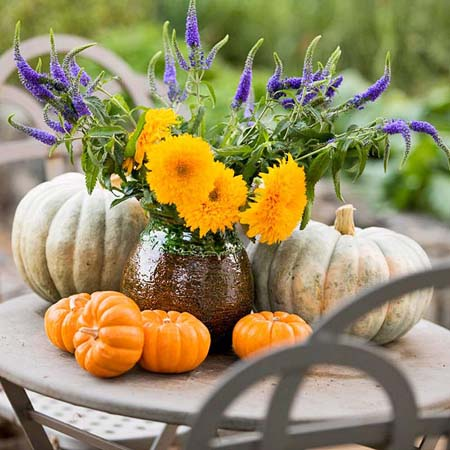 halloween decorating ideas with pumpkins and orange fall flowers