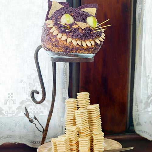 black cat is one of edible decorations for halloween party table