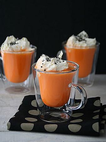orange mugs on black fabric napkins for halloween decorating