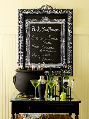 green or orange with black table decor for halloween party
