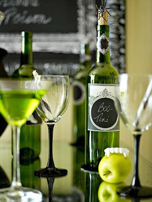 green drinks and apples for halloween party table decor