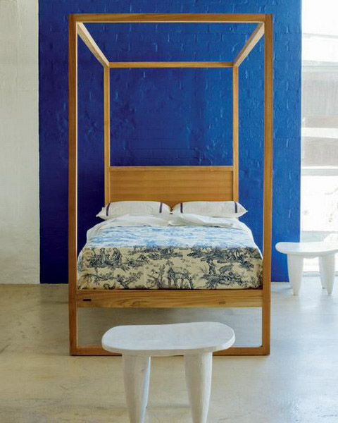 modern bedroom design with blue wall paint color and light cotton bedding fabric