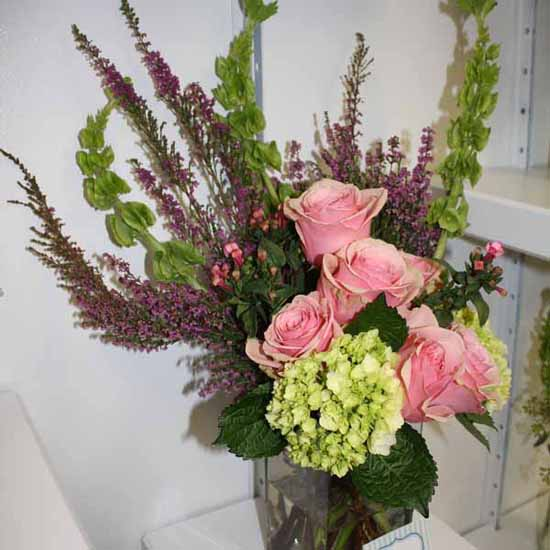 purple heather flower arrangement with pink roses