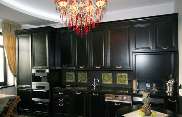 mosaic wall tiles and black kitchen cabinets