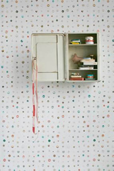 wall decorating with wallpaper and button images