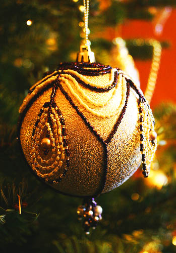 golden yellow christmas tree decorations with dark blue beads