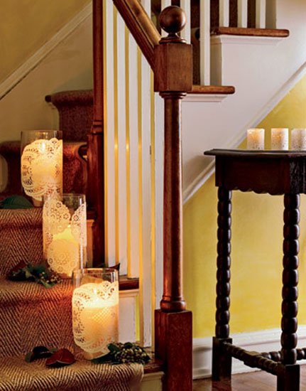 black furniture and golden candle holders for christmas decoration
