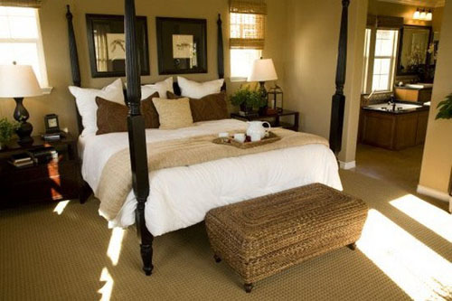 bed with posts and wicker ottoman for creating colonial homes style