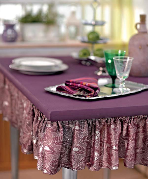 making table skirt of purple fabric and decorating table top with purple paint