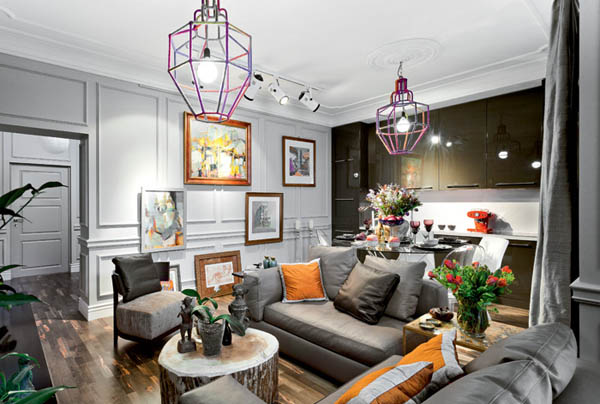 eclectic decor in neutral gray and brown colors with bright orange and golden accents
