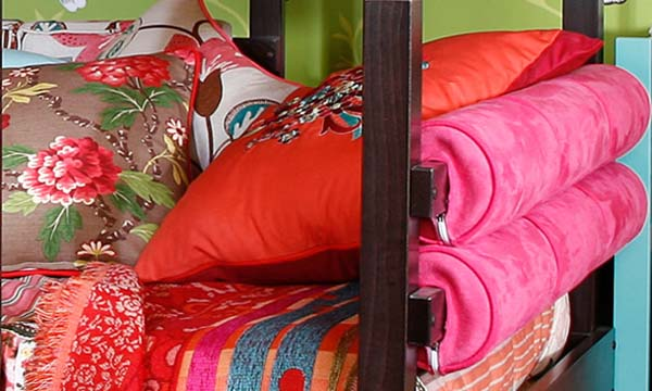 soft decorative fabrics and cushions with floral designs for girls bedroom decorating