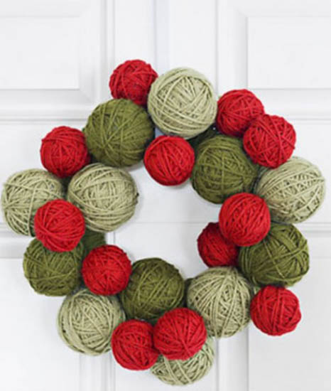 making foor wreath of red and green yarn balls