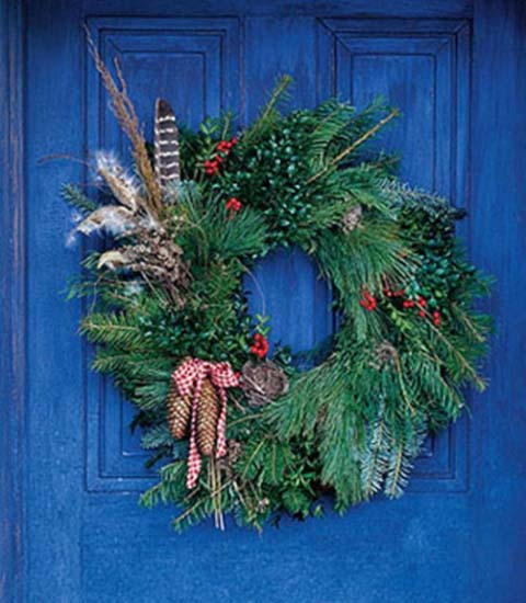 evergreen christmas wreath with pine cones and ribbons