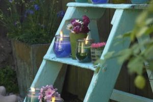 garden decorations candle holders on shelves made of old wooden ladder