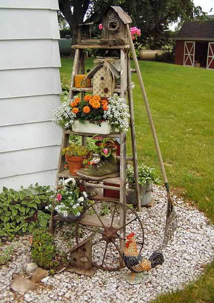 old ladder with flowers for backyard decorating