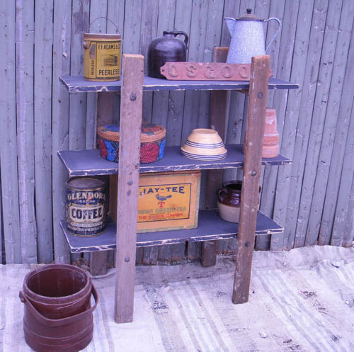 shelves made of old ladder for exterior wall decoration