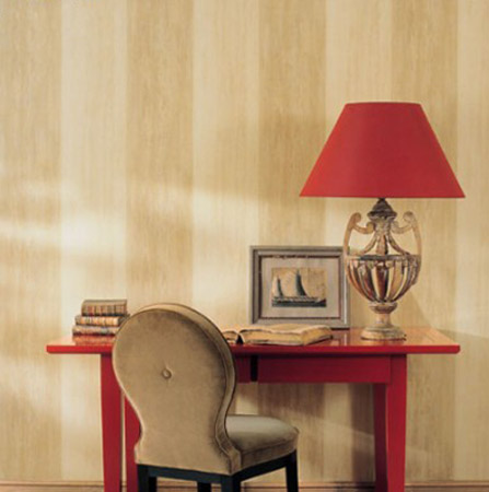 beige and cream striped wallpaper with red table and lampshade