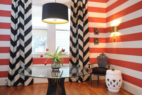 orage and black stripes on walls and curtains