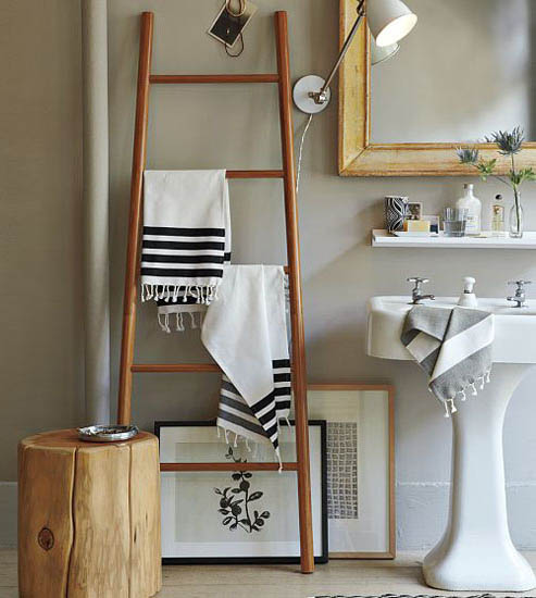 antique ladder with towels for bathroom decorating