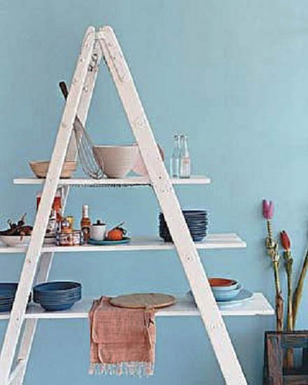 white ladder with selves for blue wall decoration