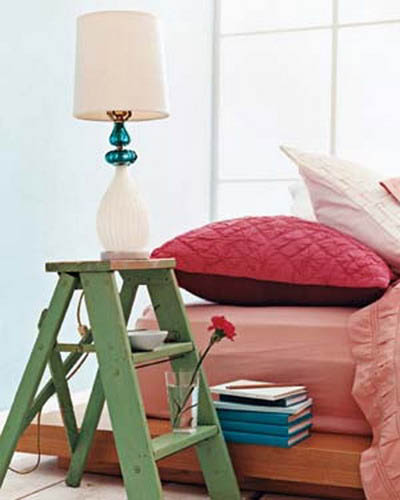 small step ladder in green color as small table for living room decorating