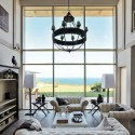 white living room furniture and antique chandelier
