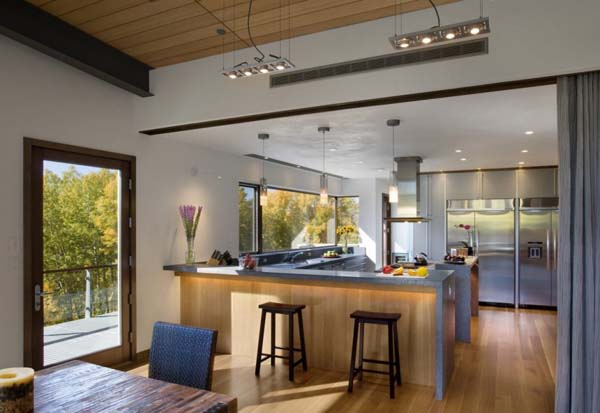 modern kitchen design with wood cabinets and dining furniture