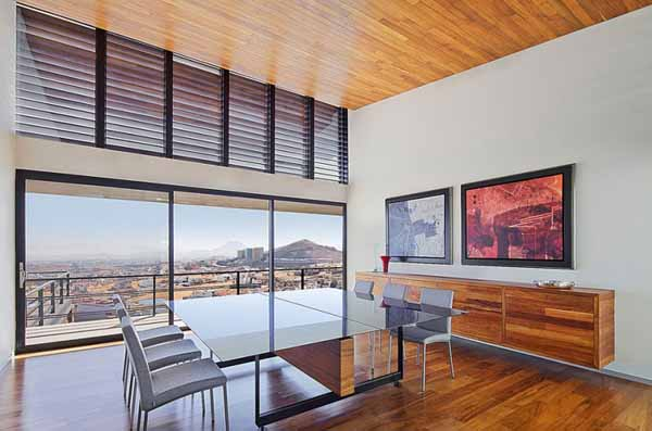 wood ceiling and floor in dining room with large windows