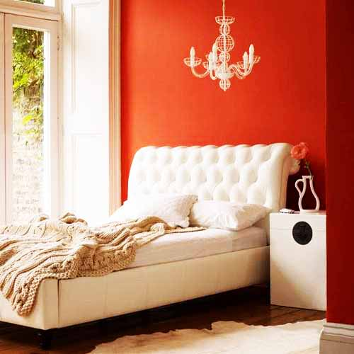 orange wal paint in bedroom