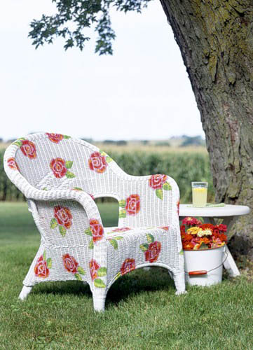 white chair decorated with rose flowers