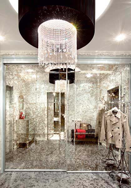 entryway decor with large mirrored closet doors