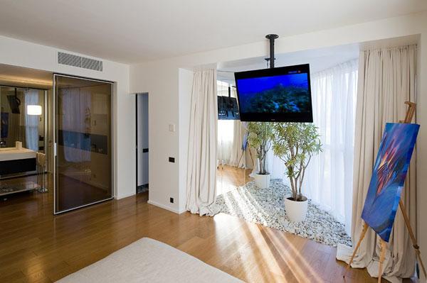 bedroom with beach stones on floor
