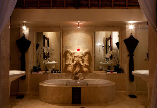 modern bathroom design with bathtub and indonesian art pieces