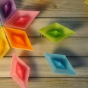 colorful candles in paper boat shapes