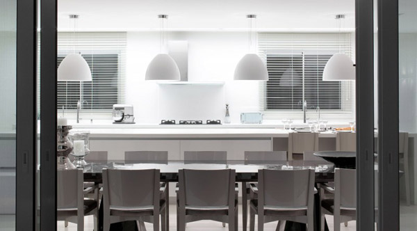 white dining furniture and pendant lights