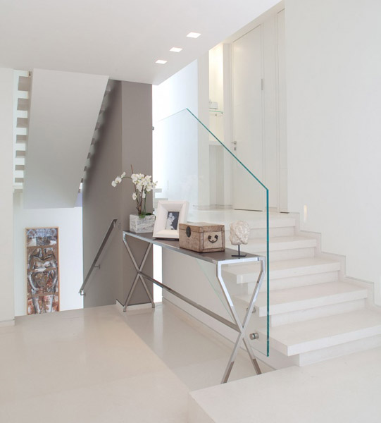 glass staircase and interior decorating in white color