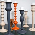 large candlesticks made of wood