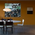 contemporary dining room with yellow wall and window