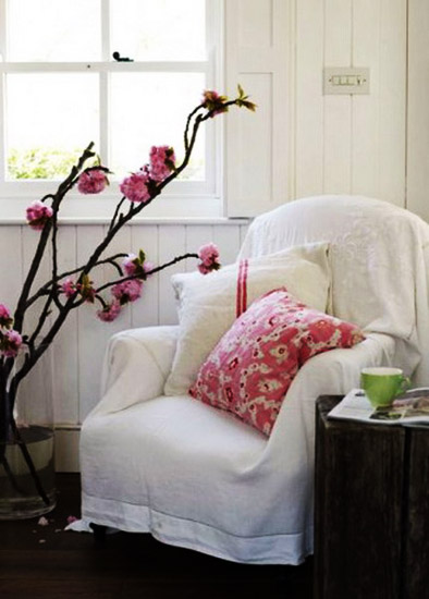 room decorating with flowering branches, room decor in white and pink colors