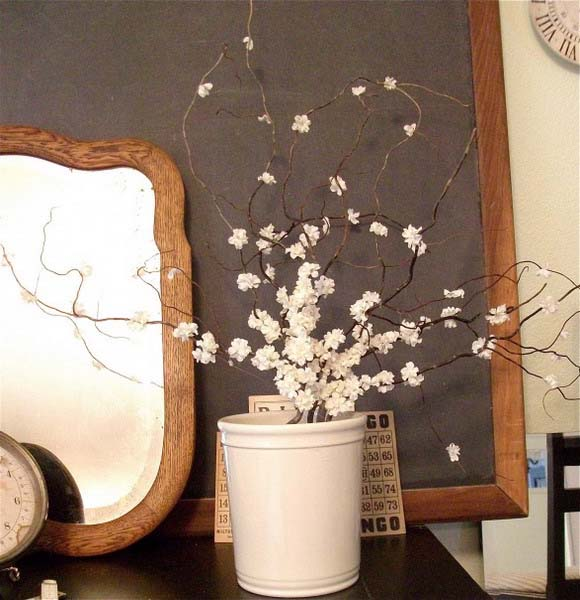 flowering branches in white vase