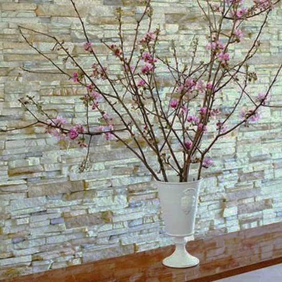 spring branches with pink flowers in white urn