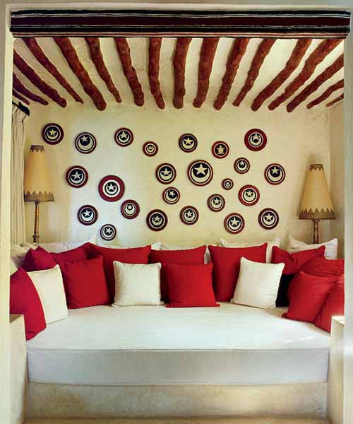 sofa with decorative pillows in white and red colors