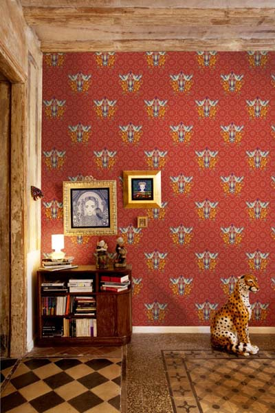 red wallpaper with floral designs