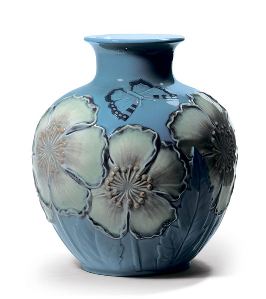 blue vase with poppy flowers