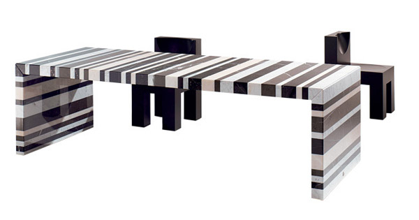 striped dining table made of natural stone blocks