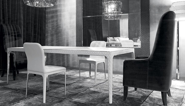 dining tabl with white legs decorated with leather
