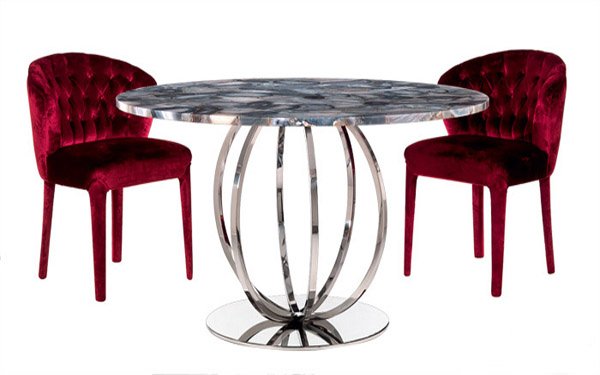 round table and two upholstered chairs in red color