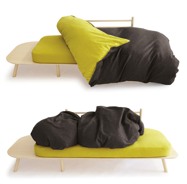 green and black duvet that makes sofa back